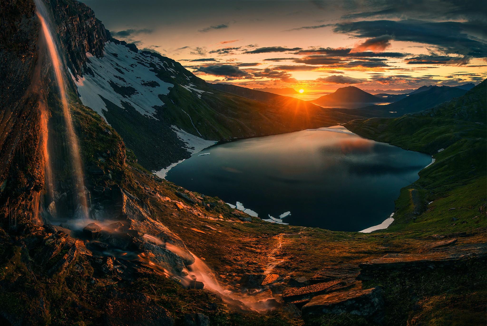 Autumn sunset over the mountain lake