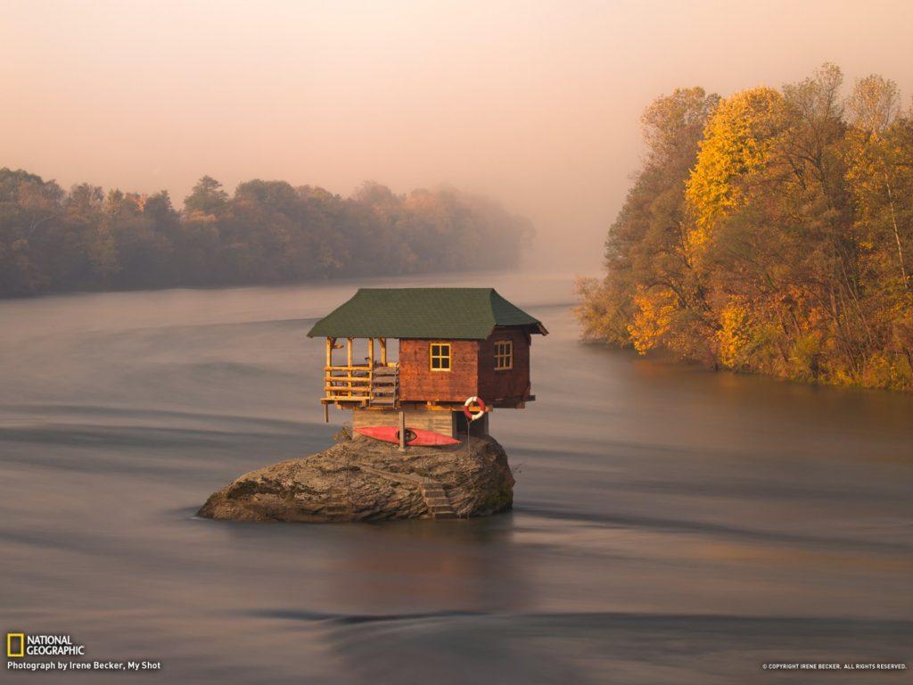 Autumn - tiny house on the river