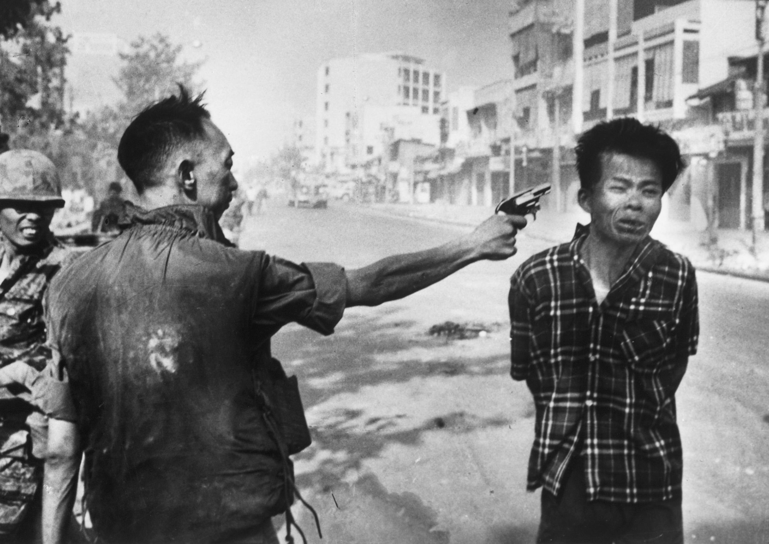 Police Chief Nguyen Ngoc Loan executes suspected Viet Cong member Nguyen Van Lem