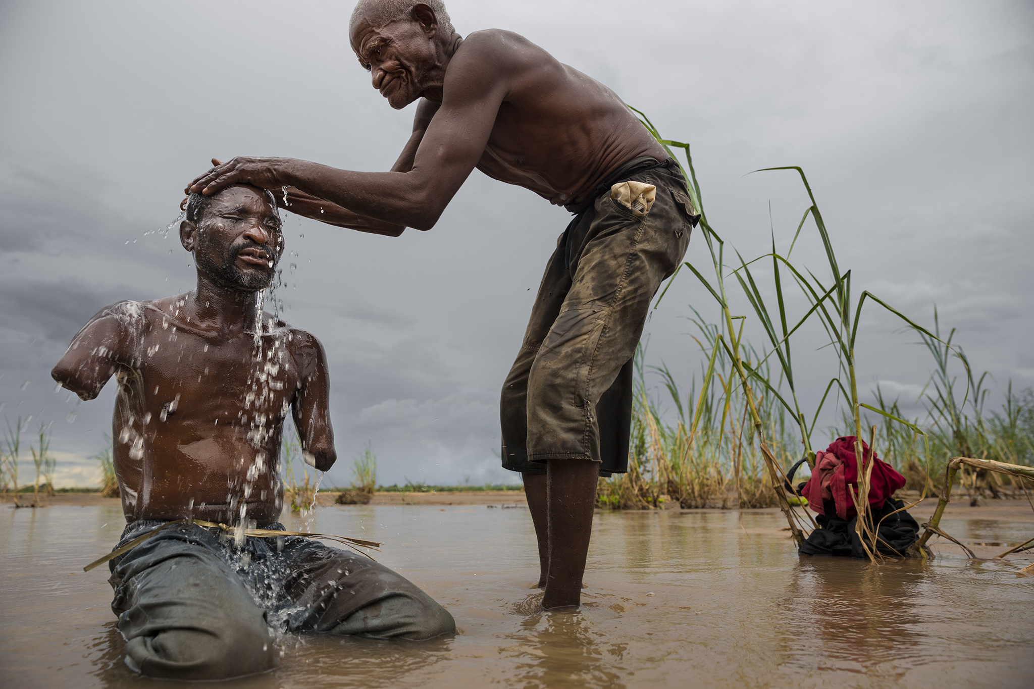 Men washing, Tanzania, 2013