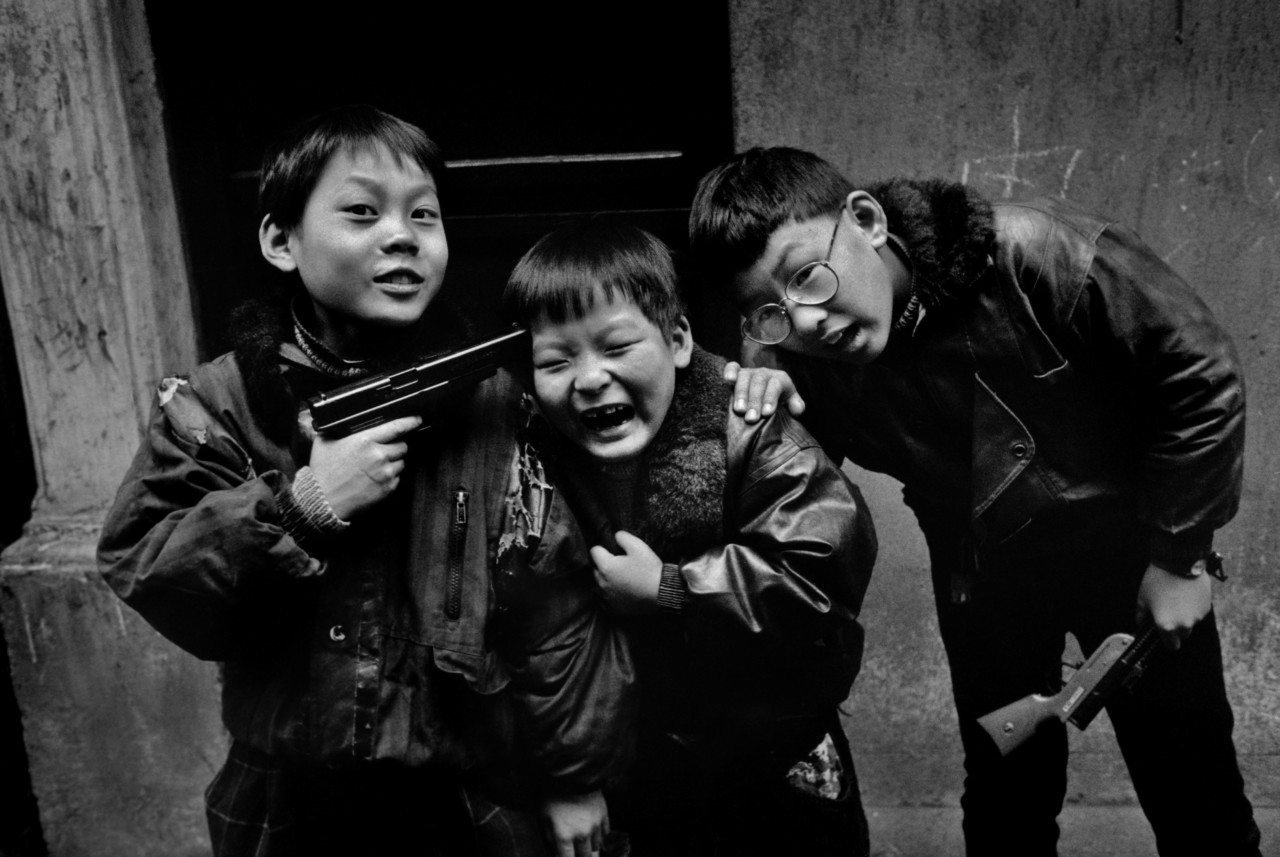 Children play with gun in Shanghai, China, 1995
