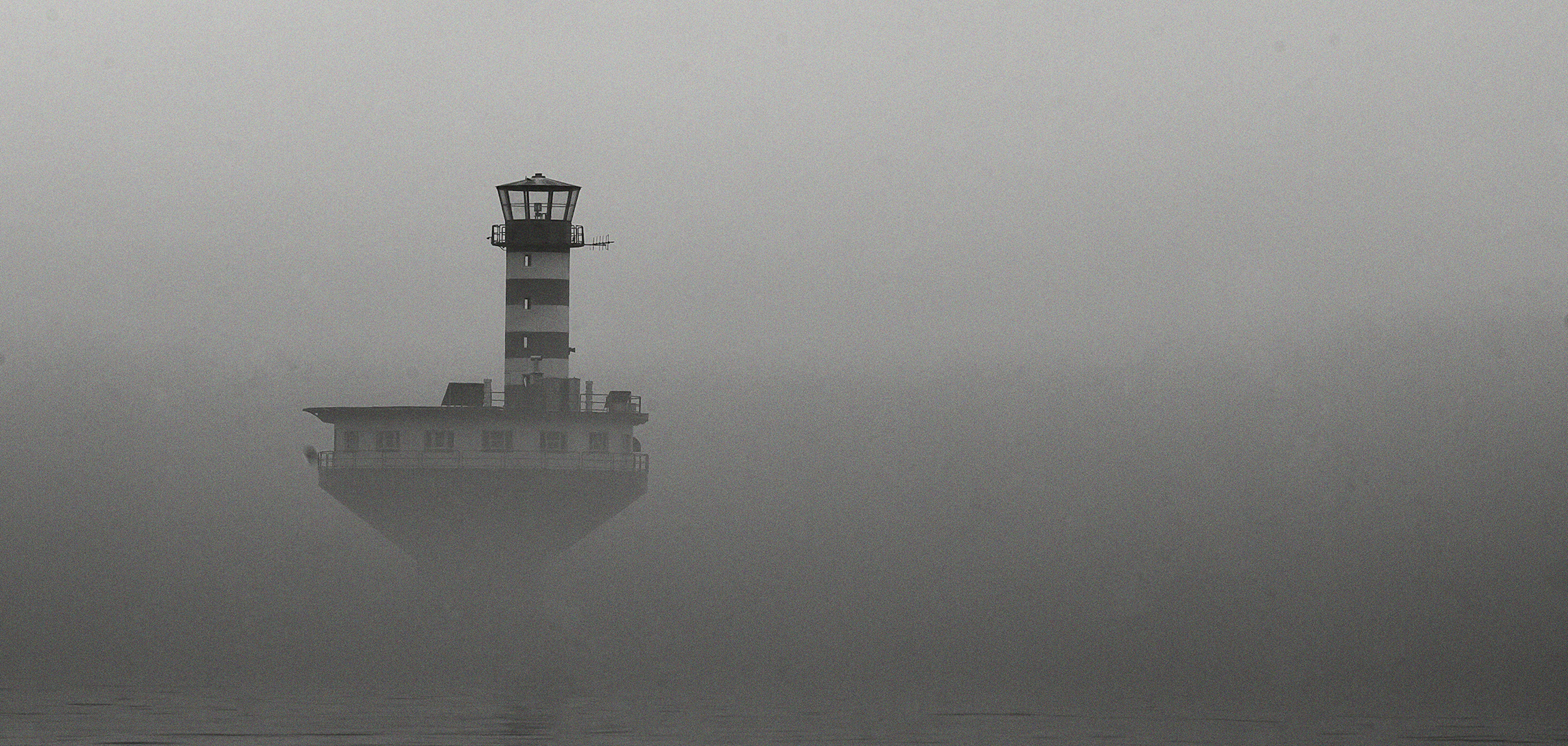 Lighthouse in the mist, Tadoussac, Quebec