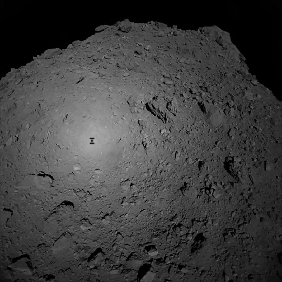 Robot Mascot landing on Asteroid Ryugu