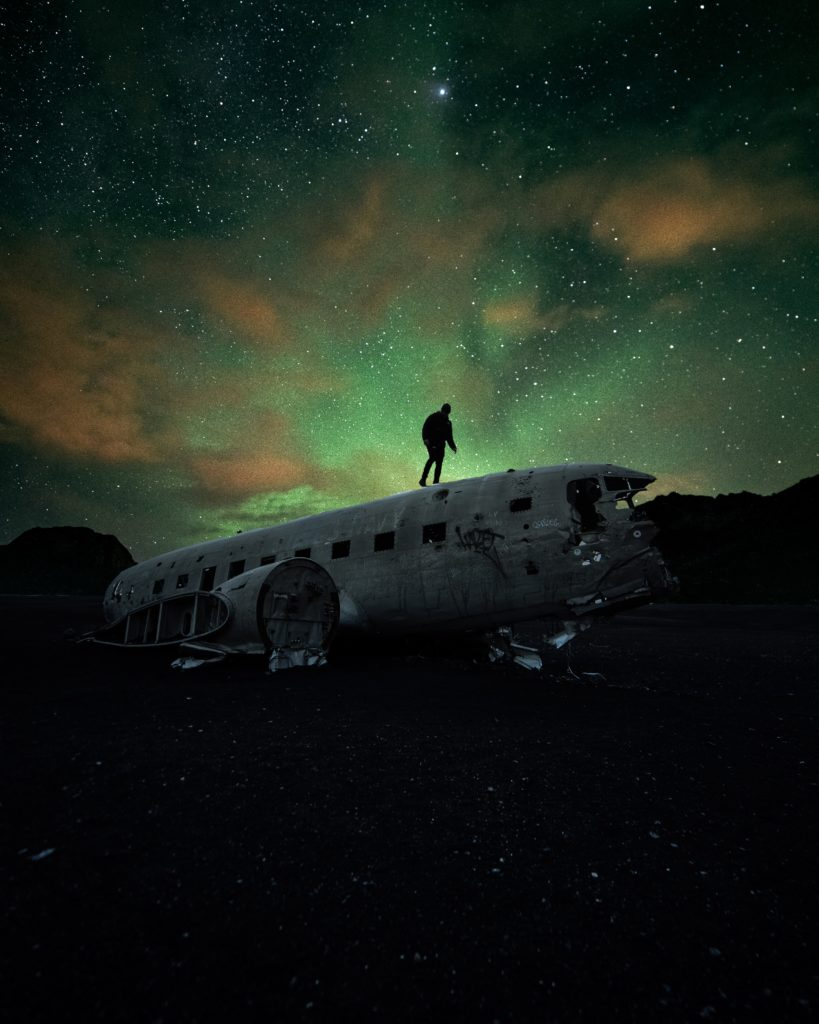 Iceland, Solheimasandur. Plane wreck, under a northern light