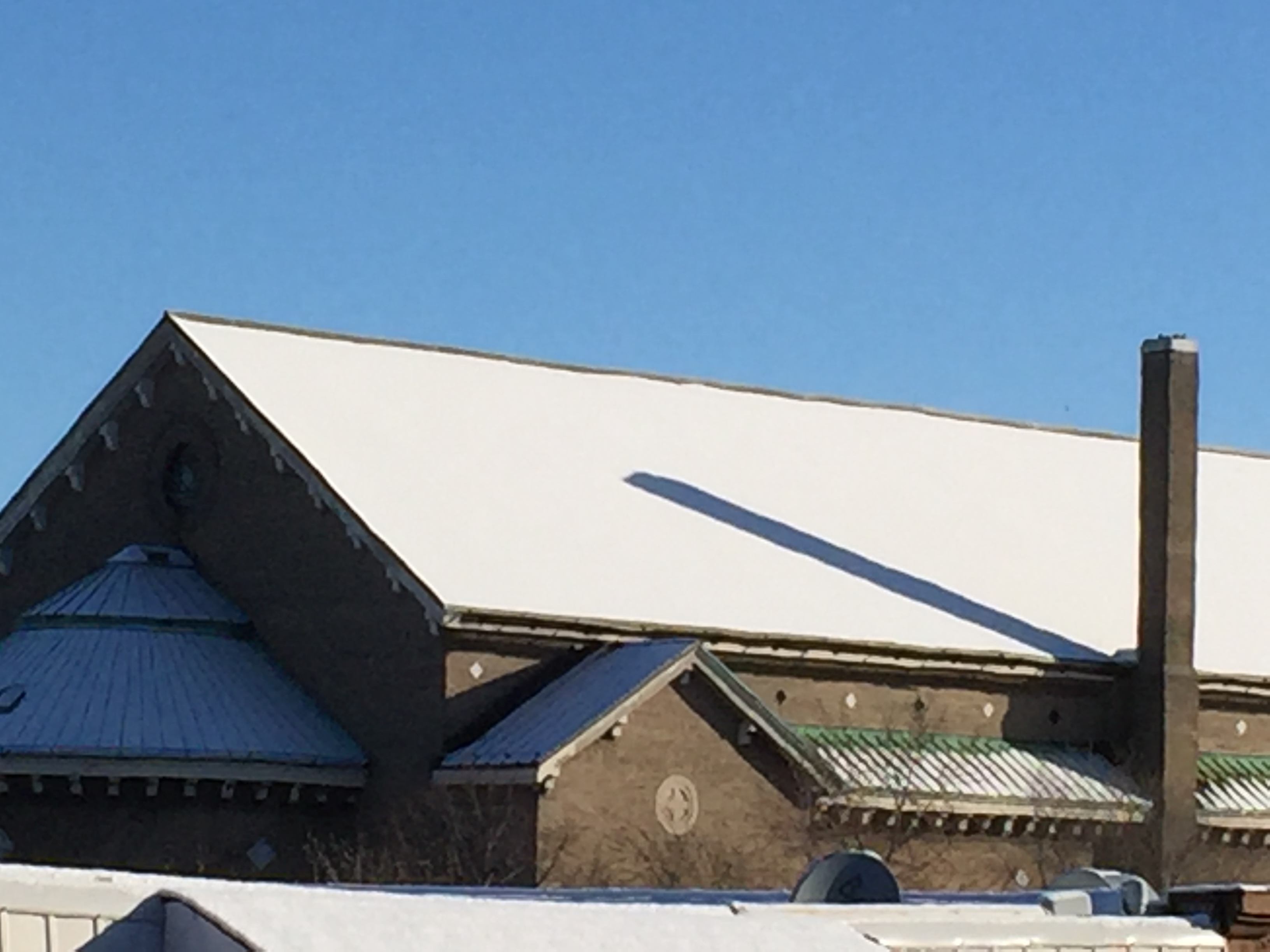 Shadow on snowy roof