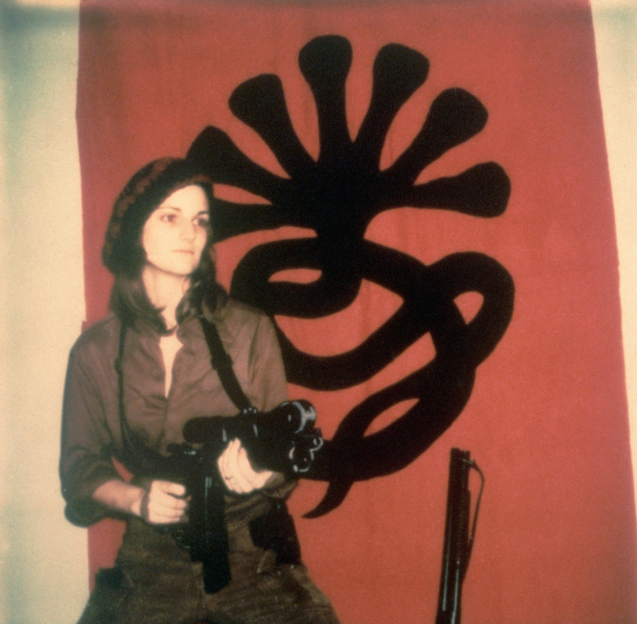 Patty Hearst, armed and impassive